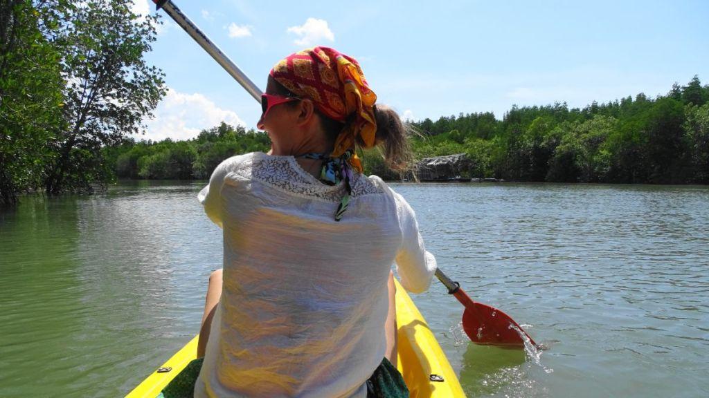 Weronika is kayaking through the mangroves in koh lanta