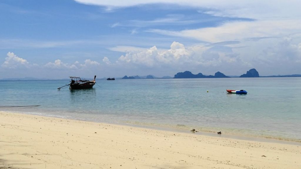 crystal clear water, karst formation and white sandy beach in Koh Ngai