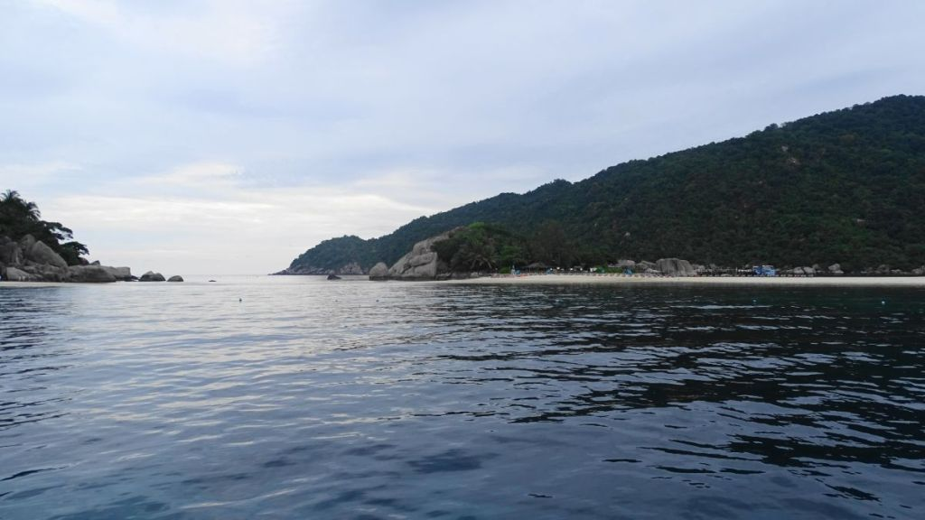 the diving site of the Japanese Gardens near Koh Nang Yuan from the boat with hills in the background