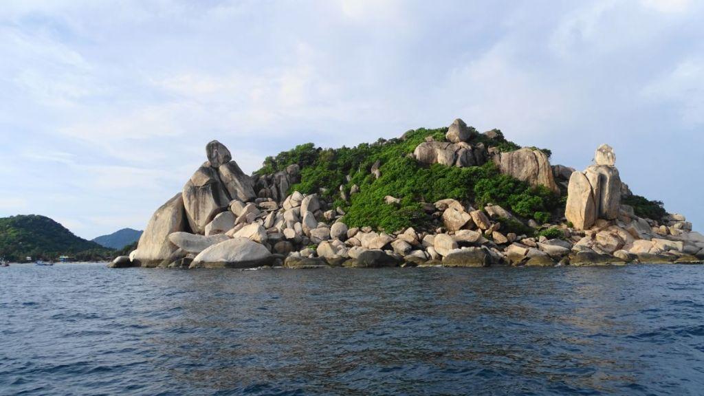 Rocky islet off Koh Tao coast seen from the boat
