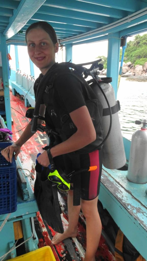 Weronika is ready to jump in the sea with scuba diving gear in Koh Tao, Thailand