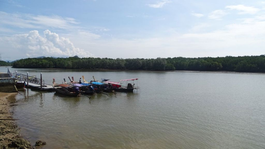 Boat jetty in Krabi river to Railay beach with mangroves in background