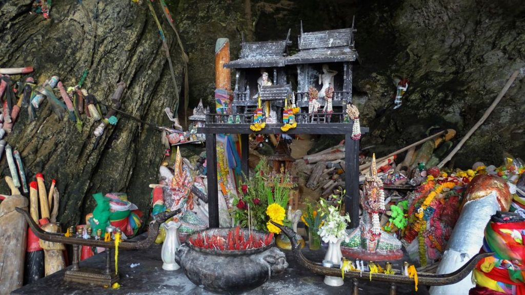 offerings in front of phallic symbols at the Phra nang cave