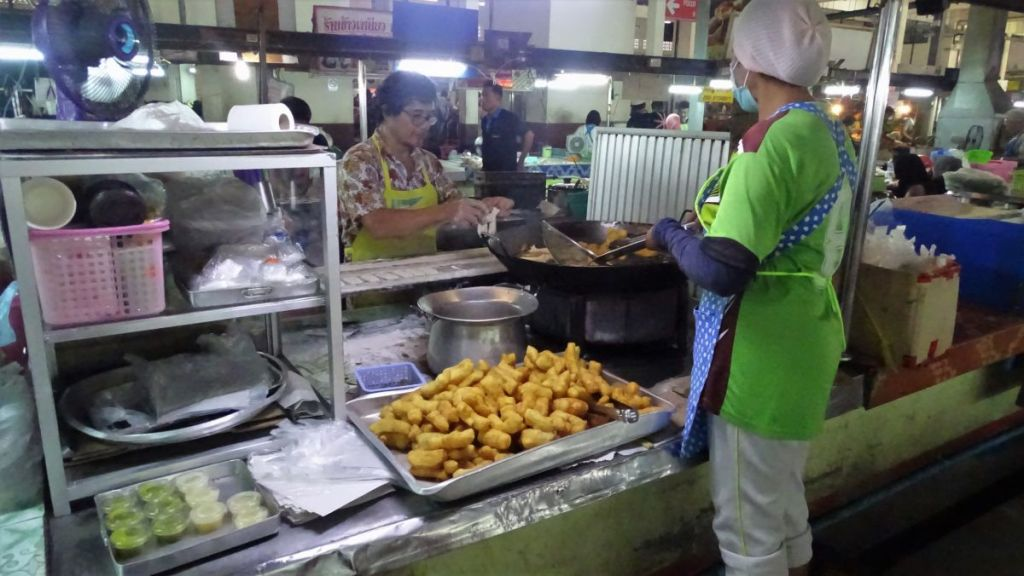 Food stall serving breakfast (fried banana) at the morning market in Krabi town