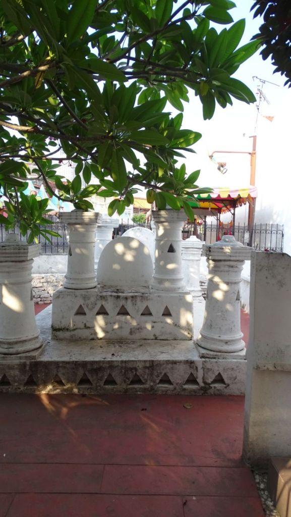 White stone Hang Kasturi tomb on Jonkers Street in Melaka