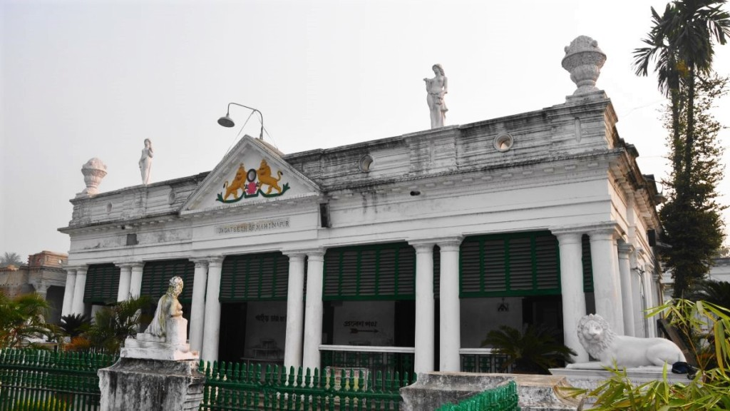 A neo-classical white building with columns and pseudo-Roman scultptures in Murshidabad, West Bengal