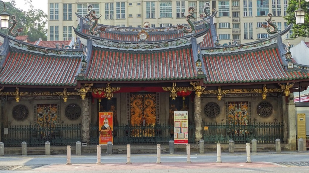 Thian Hock Keng temple in Singapore with a typical pagoda roof and beautifully painted front doors