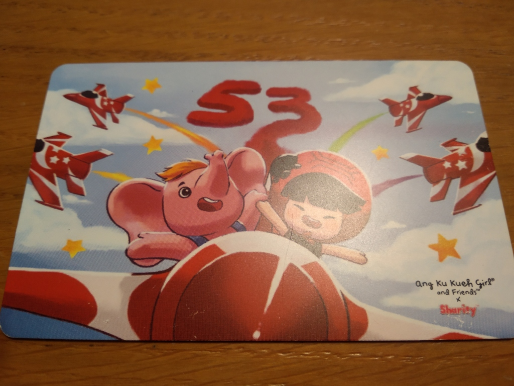 A Singaporean travelcard with a cartoon painting on the cover