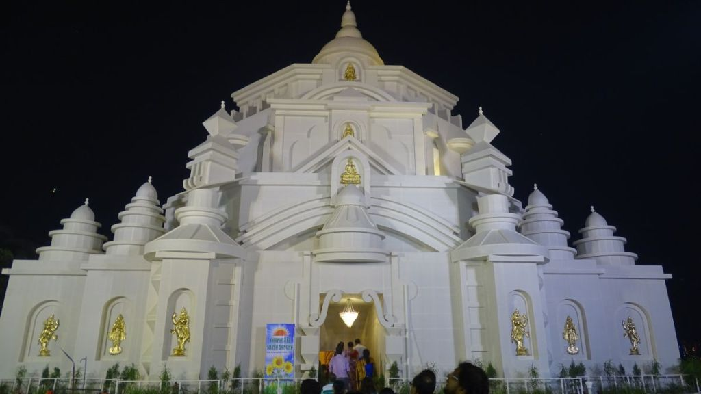 A large, white, temple-shaped pandal set for Kali Puja in Parnasree district of Kolkata