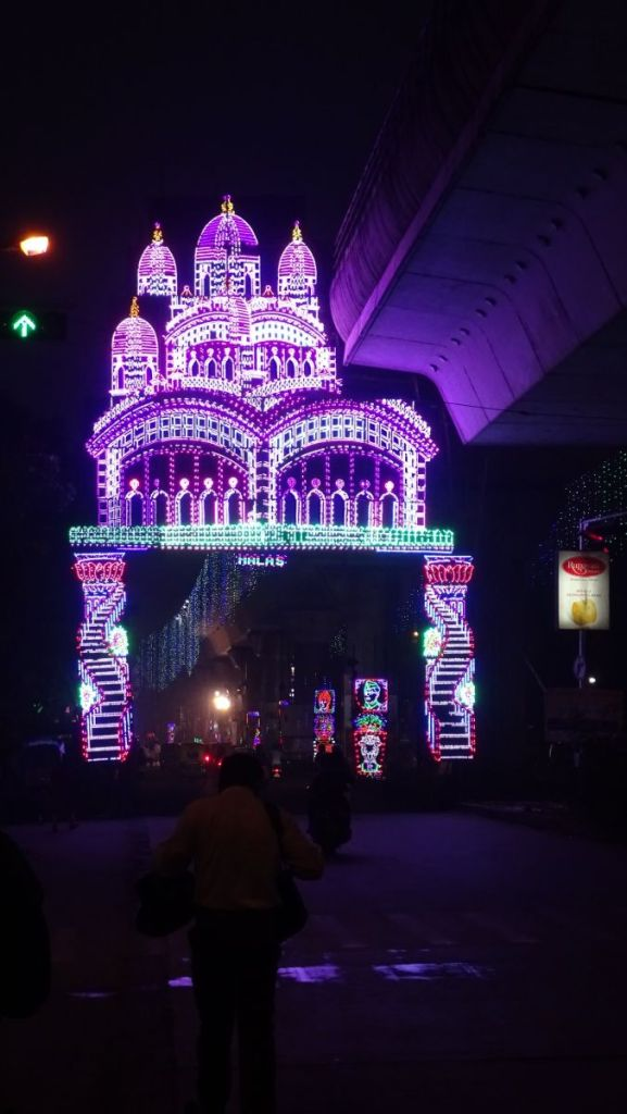 A large neon gate in a shape of a temple lit at night of Kali Puja in Kolkata