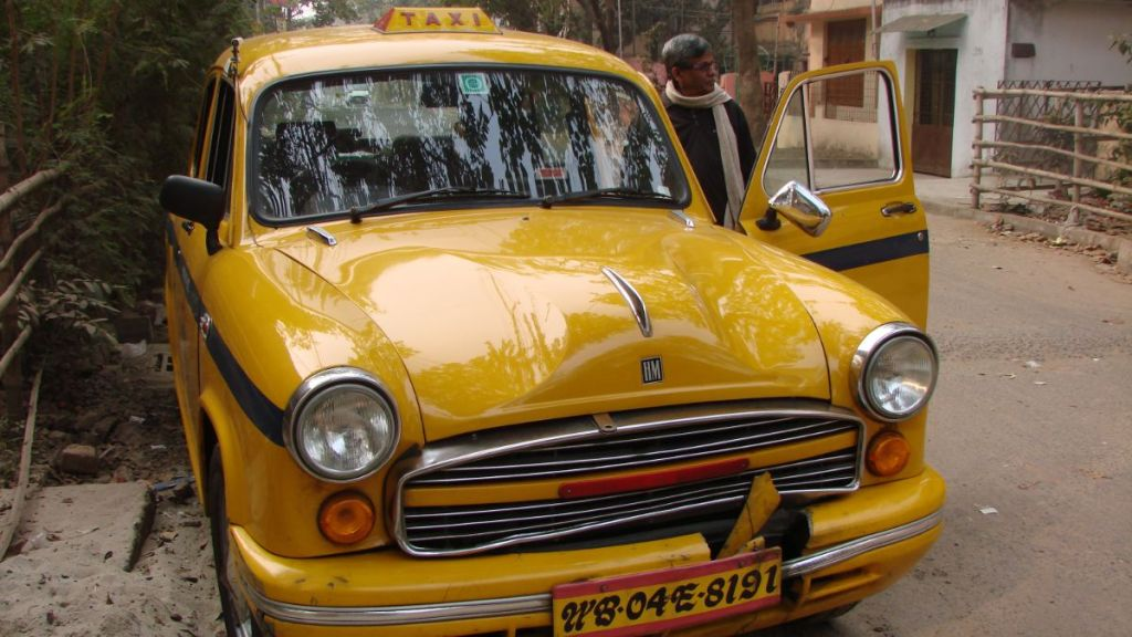 The ambassador- 1950s design Indian car serving as a yellow cab in Kolkata