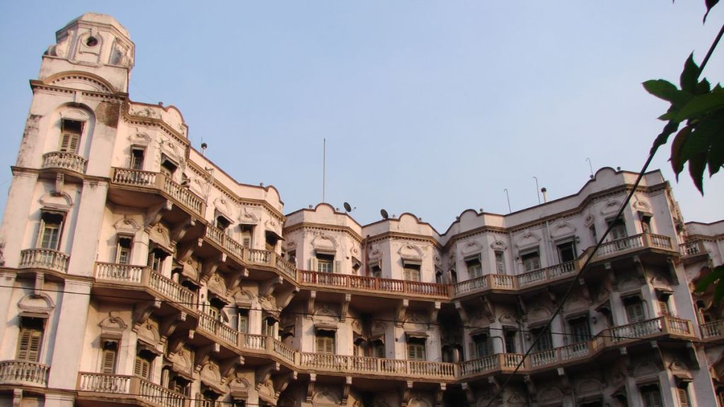 The white-colour, multi-storey 19th century building with balconies known as Esplanade Mansion in Kolkata
