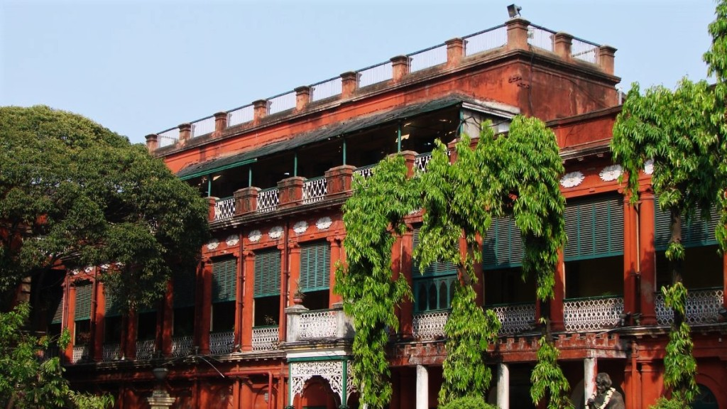 A red-brick coloured walls and green wooden shutters of the 18th century residence of the Tagore family in Kolkata