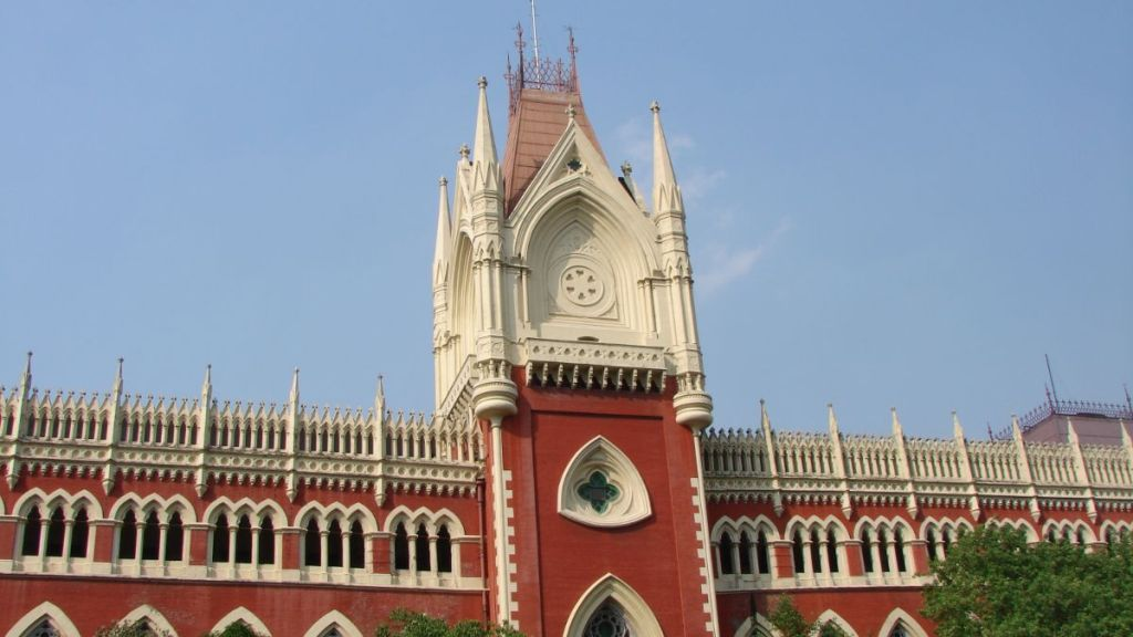 A tower of a red brick, neo-gothic building of the High Court in Kolkata