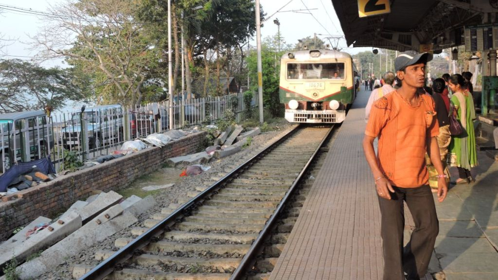 An old-fashioned circular train arrives at the station just next to the Hooghly river in Kolkata