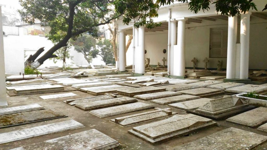 A few rows of white slate flat tombs covering the backyard of the Armenian Church in Kolkata