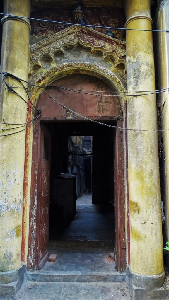 The open doorway to one of many dilapidated, 19th century buildings in the north of Kolkata