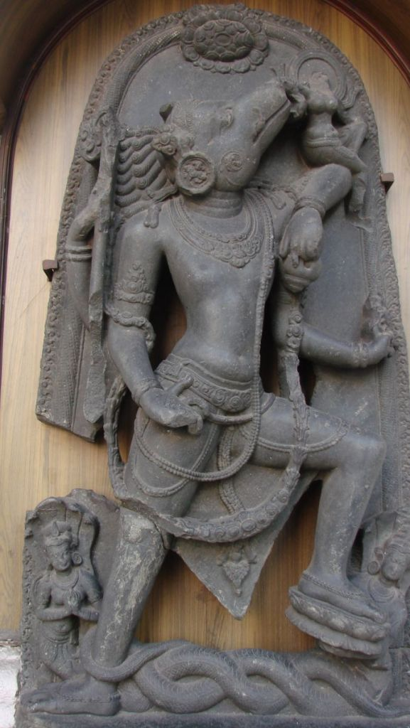 A stone sculpture of Varaha, a form of Vishnu with a human body and wild boar's head at the Indian Museum in Kolkata