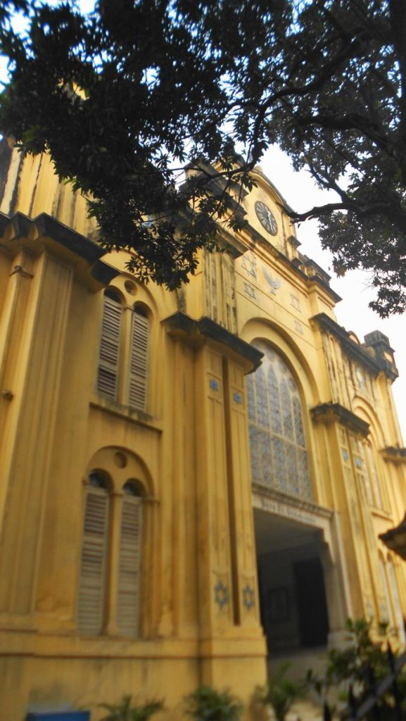 The yellow, neo-baroque facade of Beth El synagogue in Kolkata