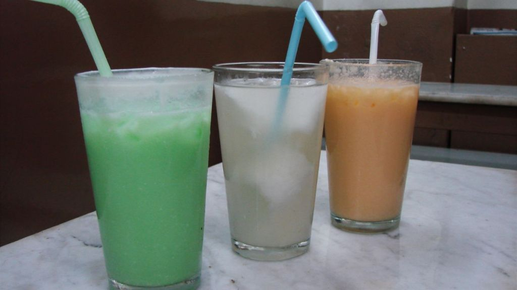 Three glasses of cool drink called shorbot, each in a different colour