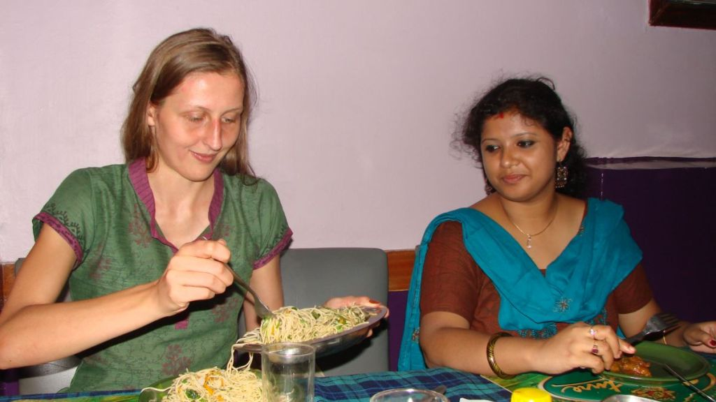 Weronika eating at a mid-range Indian-Chinese restaurant in Kolkata with her Bengali friend