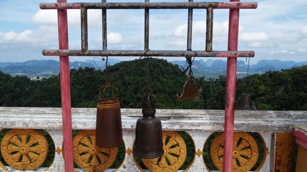 Few bells at the top of the tiger hill, krabi with view of karst formation in background