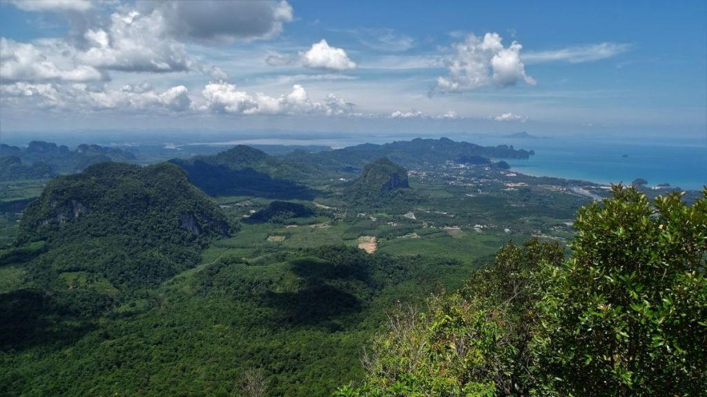 Greeneries, hills, sea and white cloud formations from the top of the Dragon Crest in Krabi