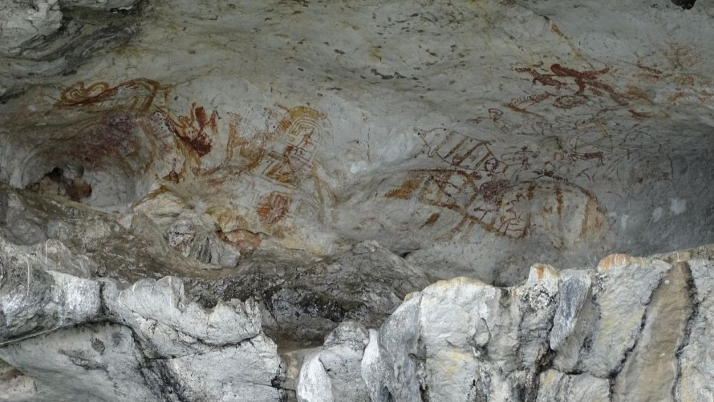 Prehistoric paintings in the wall of a Karst formation