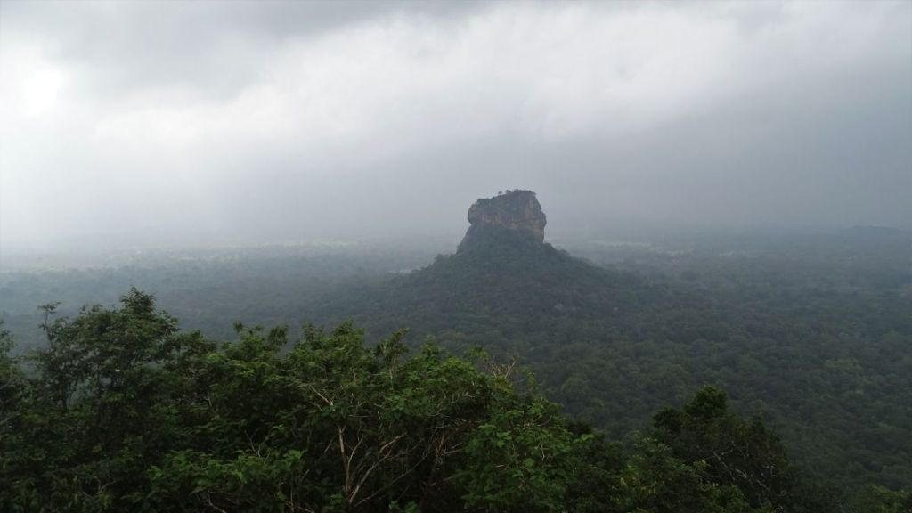 A single flat- top rock rises high above the green plains in Sigiriya, Sri Lanka