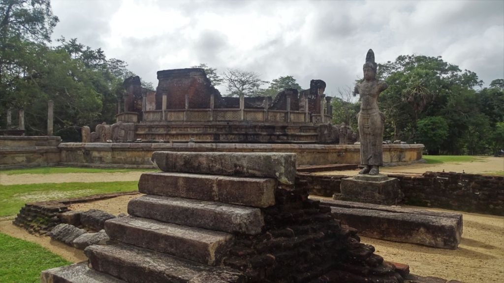 A stone statue and a circular ruins constituting part of Polonnaruwa ancient capital
