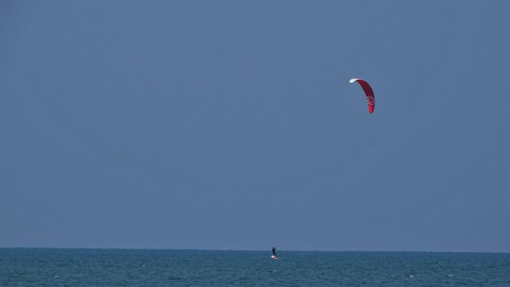 A kite surfer on the flat surface of the sea in Kalpitiya, Sri Lanka