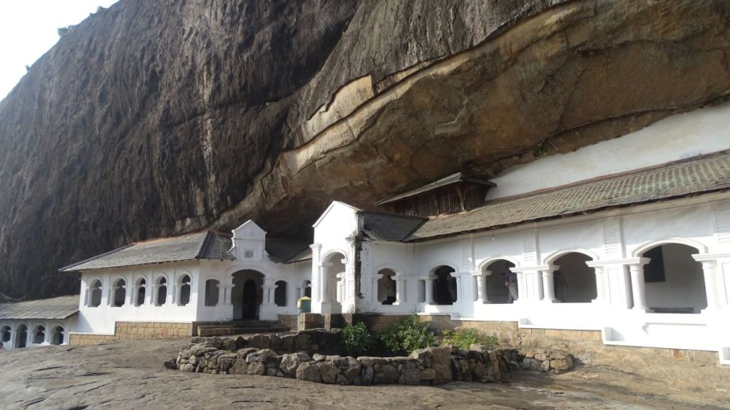 Whtie-washed arched passages of the front of the cave temple in Dambulla, Sri Lanka