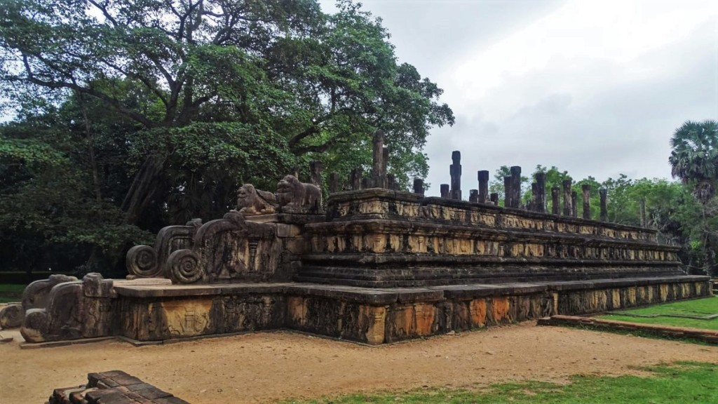 A raised, intricately carved stone platform at the Polonnruwa ancient capital site in Sri Lanka