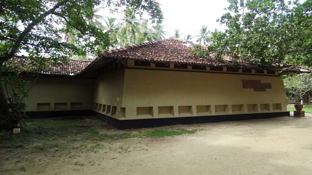 A low slanted wall building with a tiled roof housing a Folk Museum in Koggala, Sri Lanka