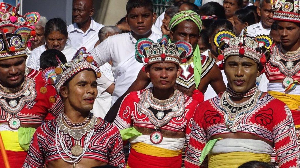 Male dancers in full make-up and crown-like, colourful headdress at the January Poya procession in Unawatuna, Sri Lanka