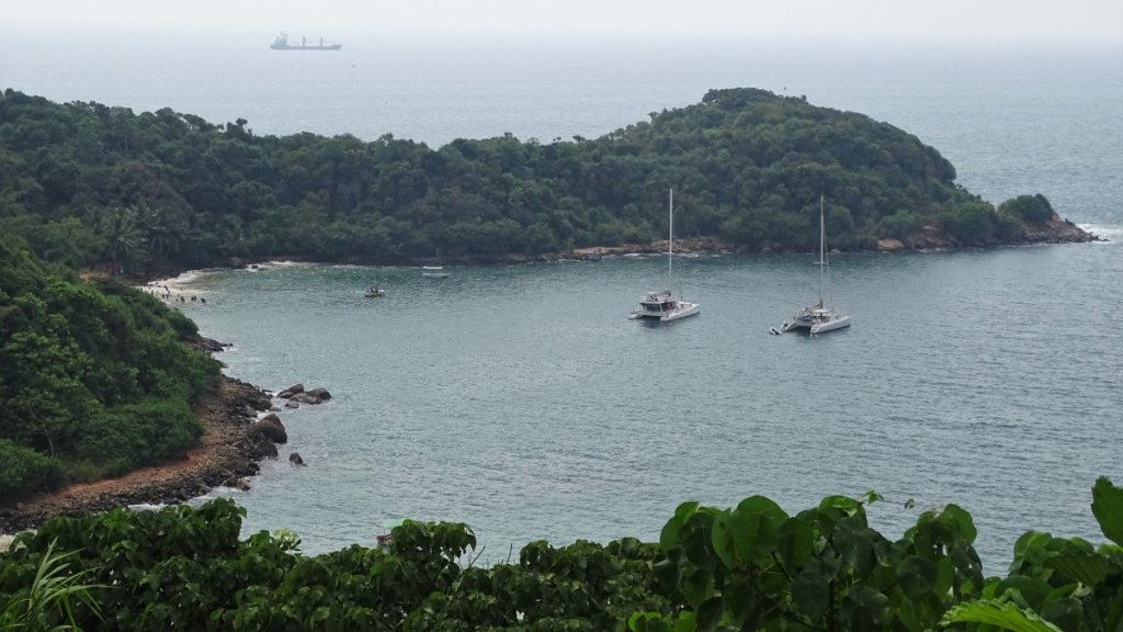 A view from above at the green peninsula and the cove with Jungle beach in Unawatuna