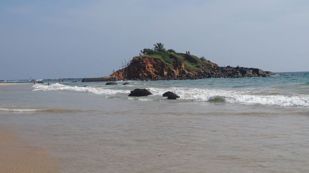 Parrot Rock: a small, red soil island just a few meters off Mirissa Beach