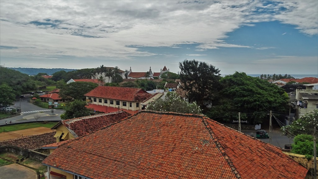 A view from Galle ramparts at the red tiled roofs and white or creme coloured walls of historical buildings inside Galle fort