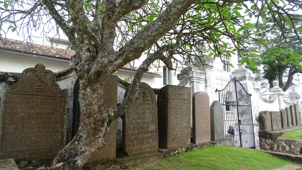 A row of 17th century tomb stones line the fence around the Reformed Dutch Church in Galle