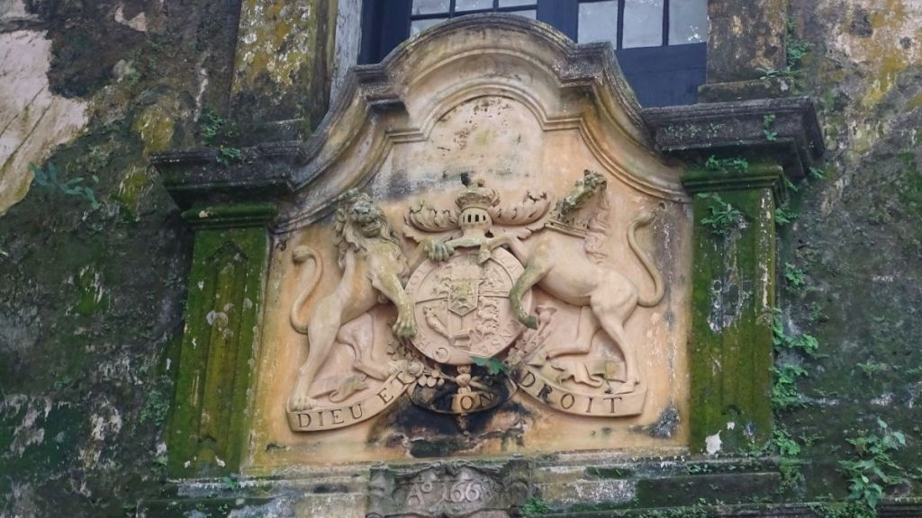 A coat of arms with a lion and a horse cut in the stone above the gate to Galle Fort