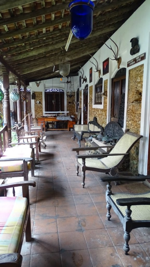 A verandah of the old Dutch residence in Galle fort, full of colonial-time furniture  and lamps