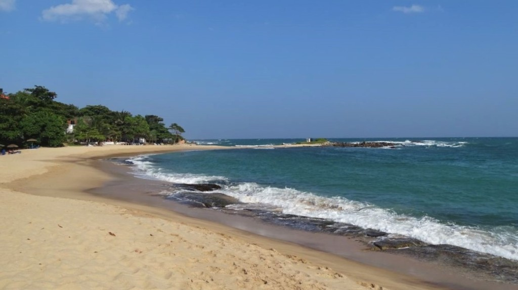 Scattered cafes and buldings at the little cove on Marakallagoda beach in Tangalla