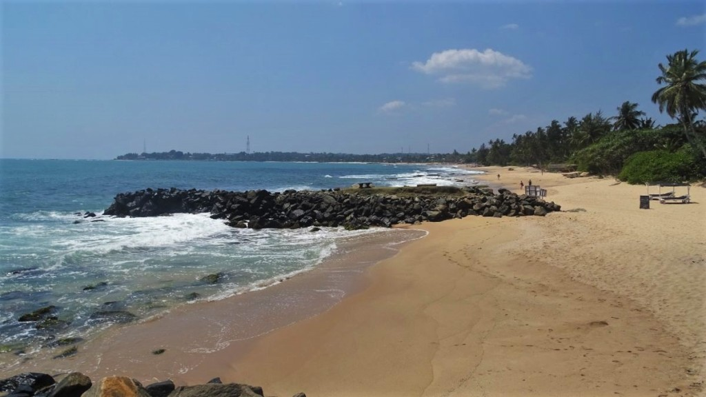 A very beach narrow strip of Tangalla beach separated by strings of wavebreakers