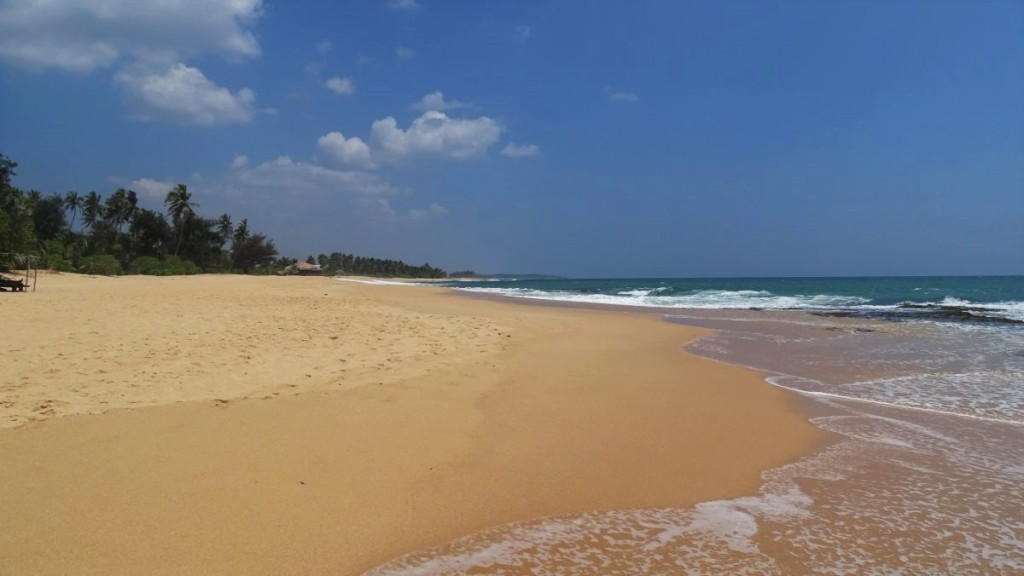 A very long, deserted, white sand beach in Tangalla