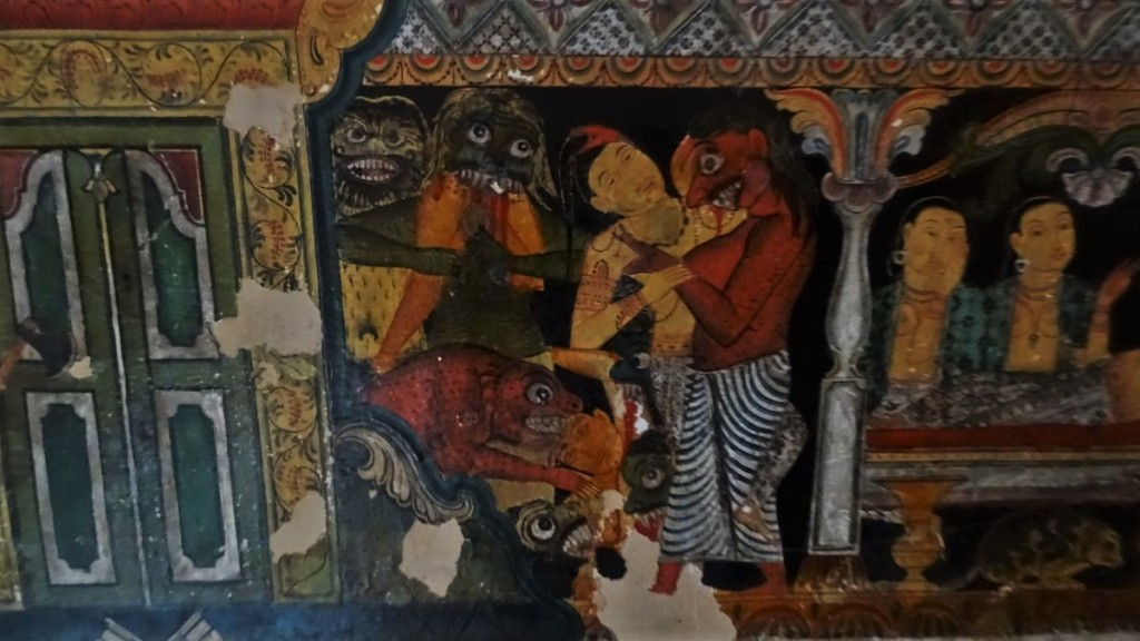 A mural in Mulkirigala temple cave depicting demons devouring humans.