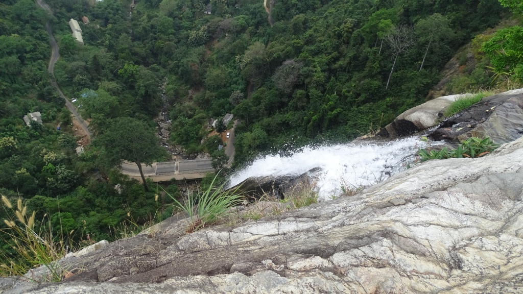 A view from the top of Diyaluma waterfall at the 200 meters drop and a road down below
