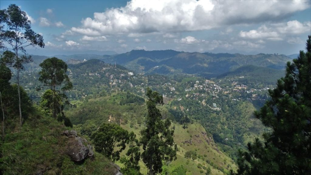 A view from Ella Rock at Ella town, sprawling over green, rolling hills