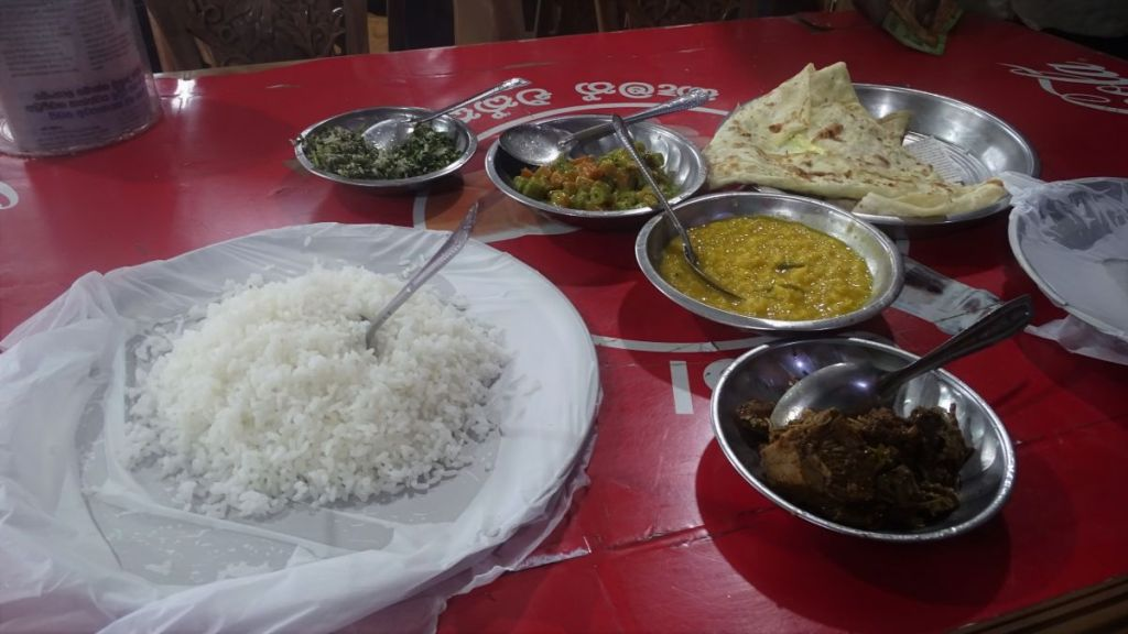 Steel bowls lined with polyethene sheets filled with rice, dal and curries at the simple eatery in Sri Lankan Up Country