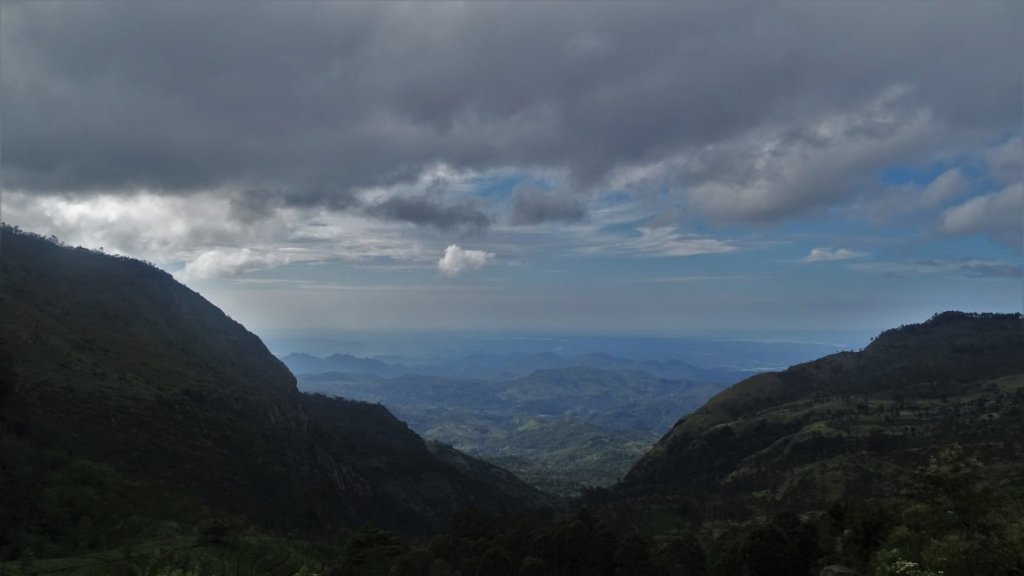 Shadow cast at a  mountain pass revealing a veiw at the hilly landscape stretching till horizon in Sri Lankan Up Country