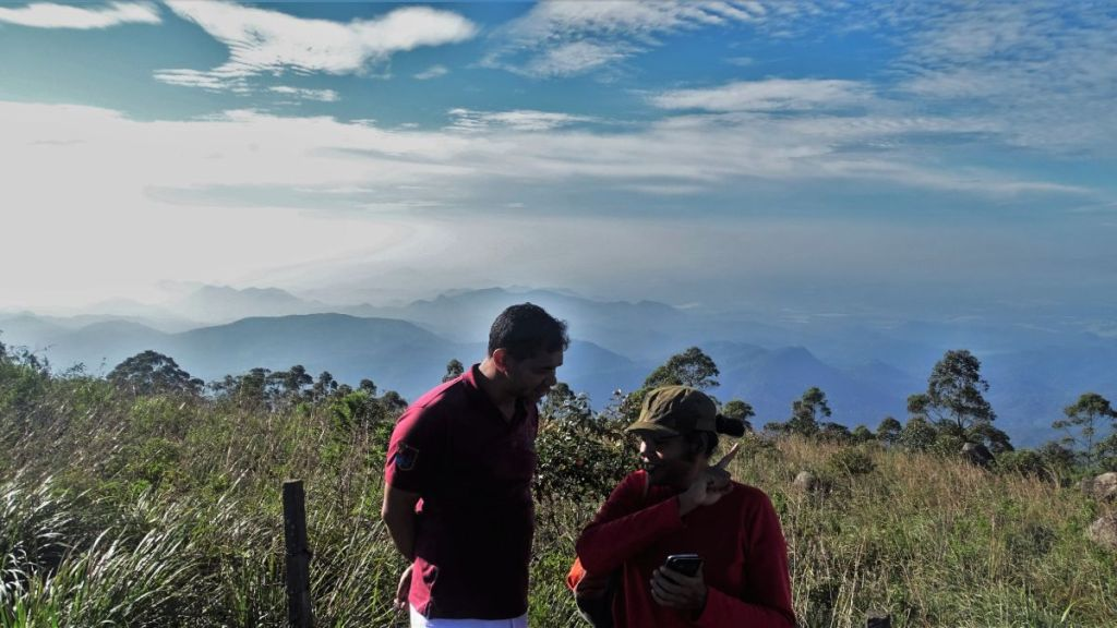 Sayak talks to the guesthouse owner in Haputale, who shows us a 360 degree panorama at the mountains and plains.